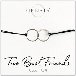 Two best friends personalized sterling silver corded bolo bracelet. Our custom cord bracelets make good gifts for best friends or sisters. Friendship bracelet with sterling silver interlocking rings on black cord.