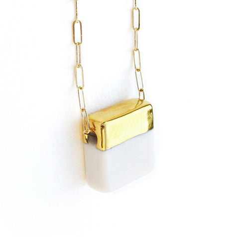 squared necklace on long chain