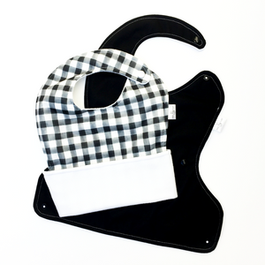 Black and white gingham waterproof pocket bib, the Ultimate Meal Bib from Milk & Sugar Baby