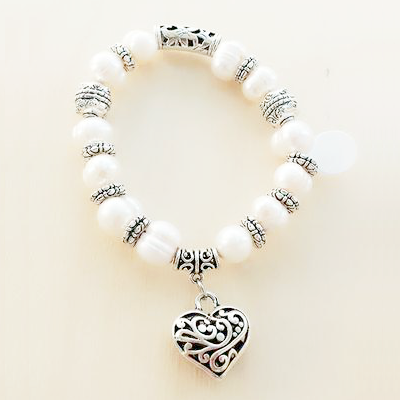 pearl bracelet with a heart charm hanging