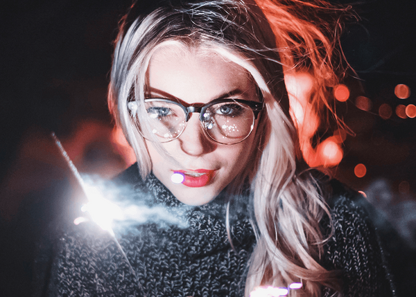 Blonde girl in clear glasses in winter time