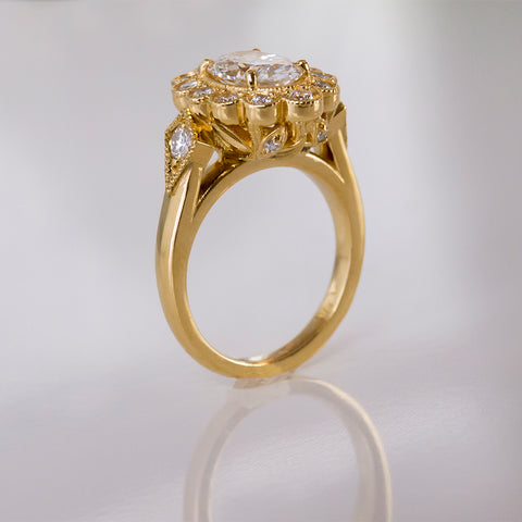 Gold ring designed by Ellie Lee Fine Jewelry features diamonds and nature-inspired design elements