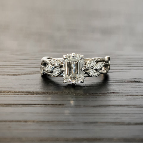 A silver and diamond nature-inspired engagement ring designed by Ellie Lee Fine Jewelry
