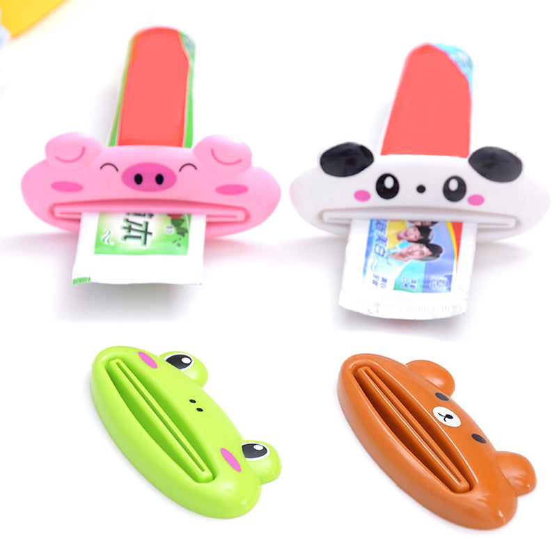 2PCS/Lot New Cartoon Easy Squeezer Toothpaste Tube Rack Dispenser Rolling Holder Easy Squeeze Paste Dispenser Roll Holder