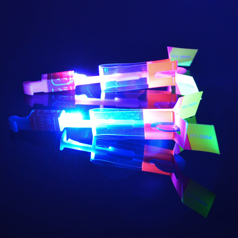 Hot sale 12Pcs Amazing LED Light Arrow Rocket Helicopter Flying Toy LED Light Flash Toys baby Toys Party Fun Gift Xmas Outdoor