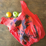 Orange upcycled quicksilver t-shirt tote bag with palm tree silhouettes and ocean wave graphics