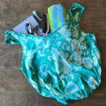 Green upcycled t-shirt tote bag with beige and aqua bleach splatter tie dye pattern