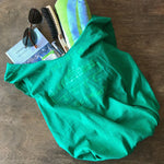 "Green upcycled t-shirt tote bag with cucumber graphic that says ""cool as a cucumber"""