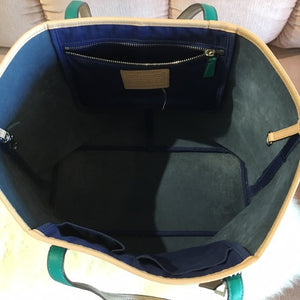 Tri color Coach bag! Beautiful royal blue color! Accented with tan and teal! Love this bag!! Even has a silver coach charm! Great condition except for some fraying on the strap.