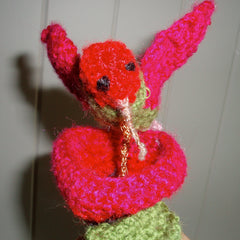Crocheted hummingbird on a flower