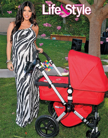 Kourtney Kardashian with a red Bugaboo Buffalo