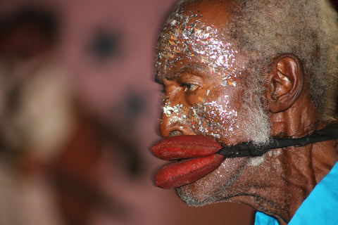 A photograph of a Cuban man during Carnival 2004 shot by Christopher Porche-West.