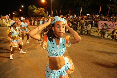 A Cuban girl dancing during Carnival 2004 by Christopher Porche-West.