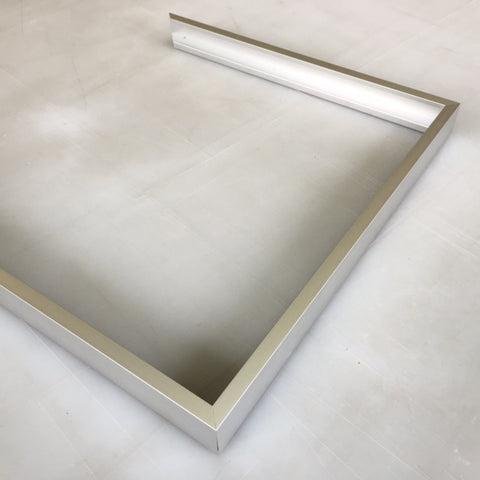 Slide an adjacent frame side onto the protruding corner plates and tighten with a screw driver. Repeat to create a U shape with three frame sides