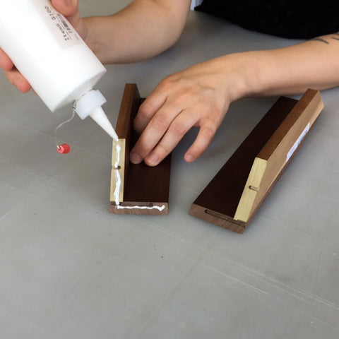 Wood glue is applied to the miters and the parts are placed together to form a corner