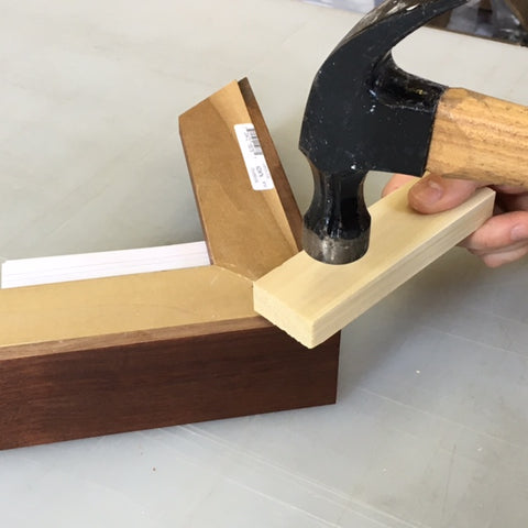 Use a piece of wood to in between the hammer and the dovetail