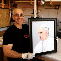 Portrait painting of Pope Francis by Oscar Lopez Rivera framed at Frames and Stretchers.
