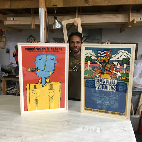 Frames and Stretchers with two framed art posters of Cuban animator and director Juan Padron's