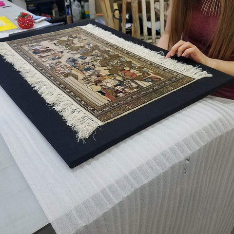 Frames and Stretchers framing an antique tapestry using complex sewing techniques.