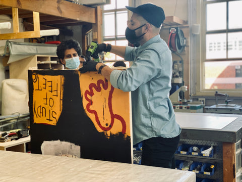 stretching-Jean-michel-basquiat-canvas-frames-and-stretchers-nyc-new-haven-miami-expert-framing-art-shipping-US-international