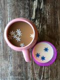 Edible Colored Snowflakes in coffee and milk Frozen