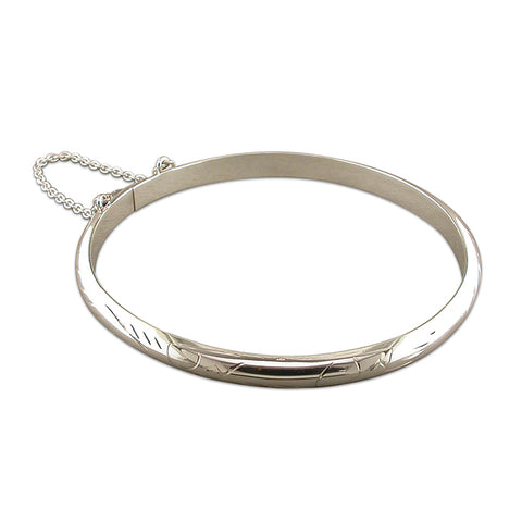 Silver engraved hinged bangle complete with presentation box