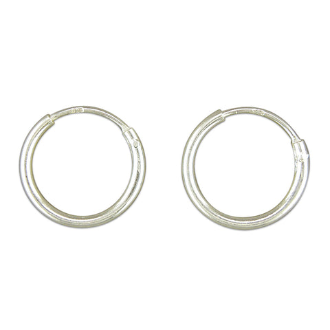 Silver hinged wire hoop earrings complete with presentation box