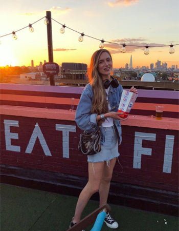 girl posing in front of sunset at London Rooftop Film Club