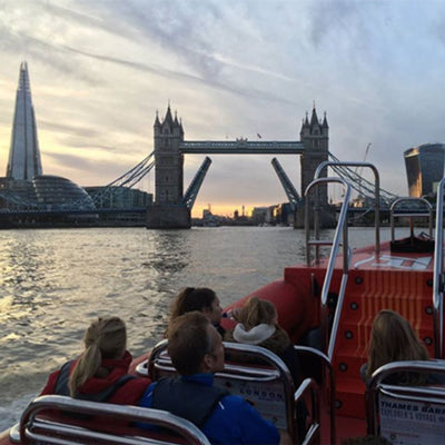 people on Thames Lates boat trip overlooking London