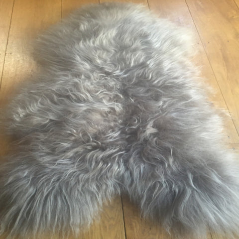 "Dimensions Approx 113 cm x W 82  The wool is long and ""shaggy"" in appearance and sumptuous to the touch.  Each rug is of premium quality being carefully processed to preserve their natural beauty. bringing outdoor natural beauty into a home. As with all our products the sheepskin rugs are a sustainable and Eco-Friendly product."