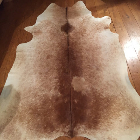 Cream/Sandy Beige Cow Hide         Dimensions L 227 x 190 W cm