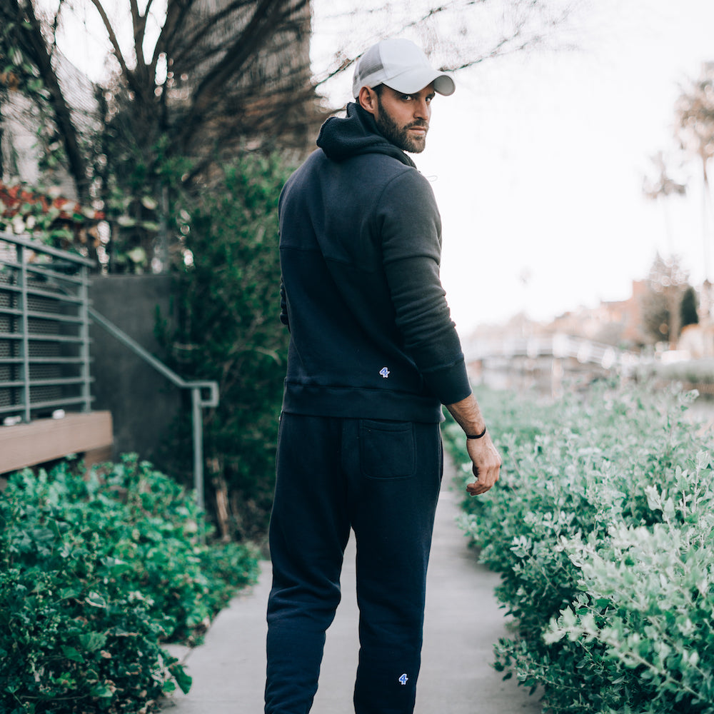 Robbie Hayes in Navy Rush Jogger and Rush Hoodie