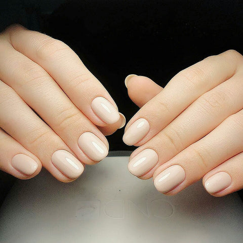 beautiful almond shape nails in cream color