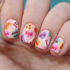 valentines day nails painted like be mine candy
