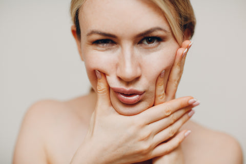 common skincare mistakes, woman doing facial exercises