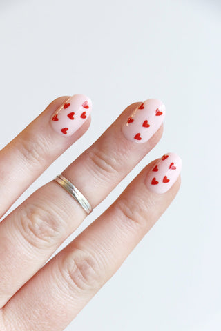 nails with red heart decals for Valentines Day