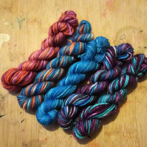 Set of mini skeins on British BFL DK yarn - in shades of blue, purples, and orange - inspired by November Rain by Guns and Roses