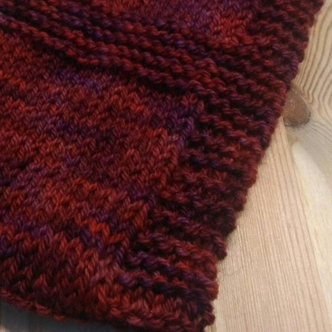 close up of knitted cowl in hand dyed yarn