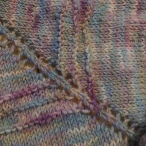 Close up of knitted shawl in hand dyed uk merino yarn