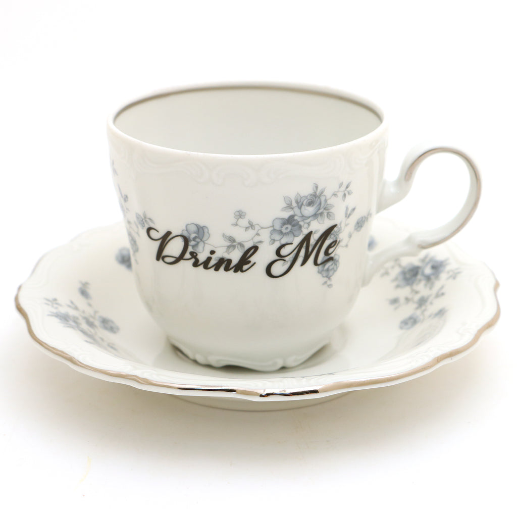 Drink Me, Alice in Wonderland teacup and saucer, upcycled, silver accents