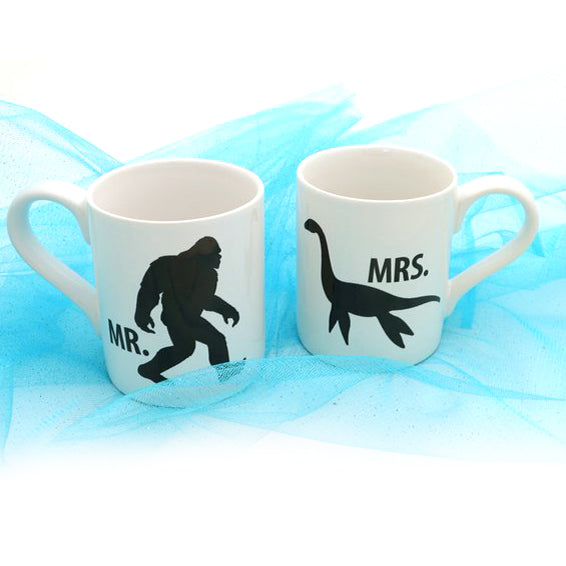 Bigfoot, Lochness Monster Mug Set. Front features Bigfoot on one, Nessie on the other. The back of