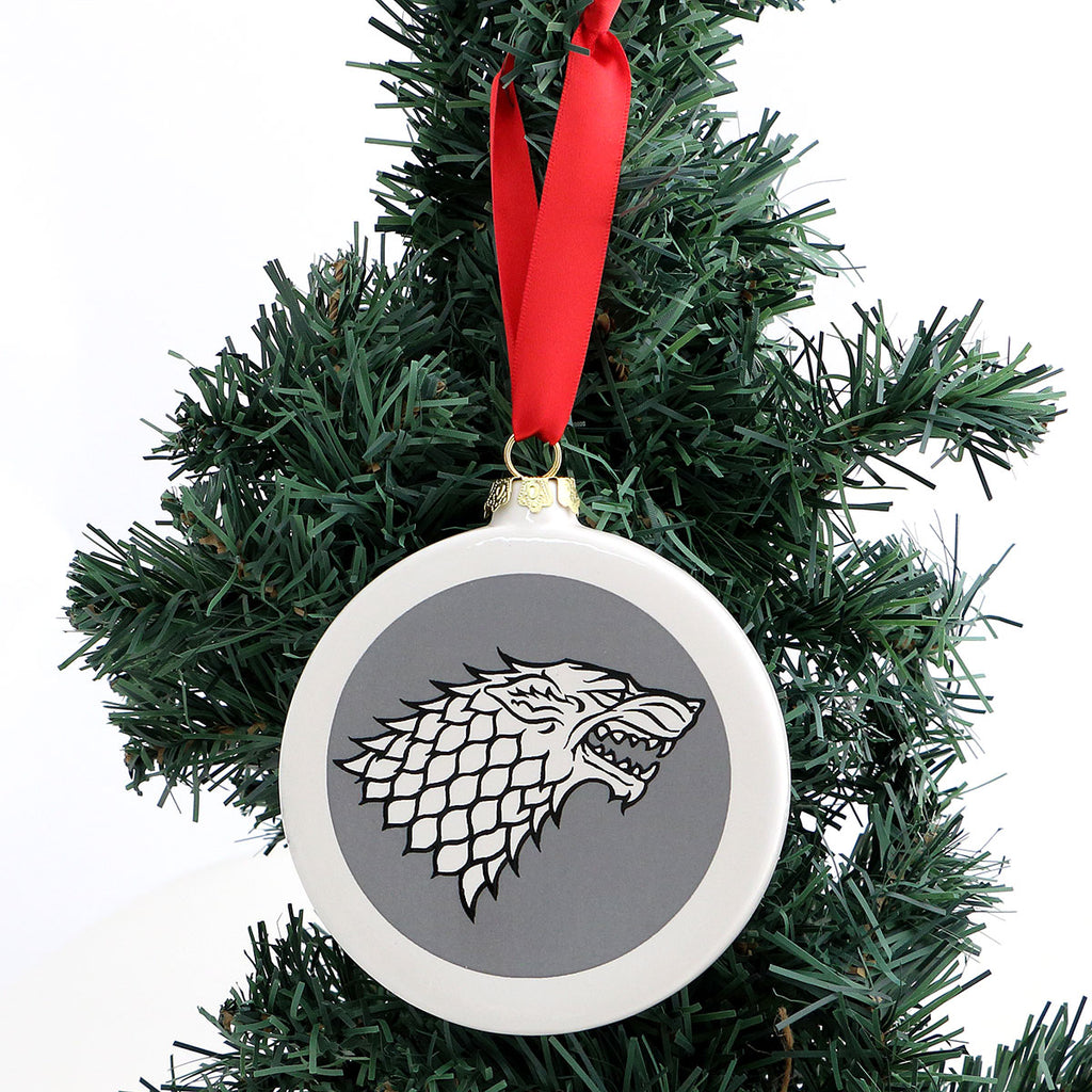 "Double sided ornament feature Game of Thrones Direwolf and ""LET IT SNOW"" on reverse side. Winter i"