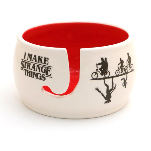 "Stranger Things inspired yarn bowl reads ""I make Strange Things."" This handmade ceramic yarn bowl"