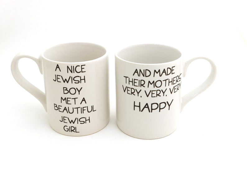 You won't kvetch about this double sided set of mugs. Fronts read: A beautiful Jewish Girl met a n