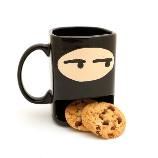 Sneak a cookie silently with this handmade ninja cookie mug. It has a special compartment for cooki