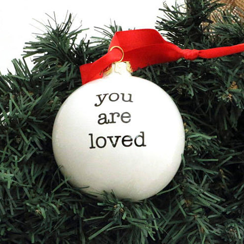 Handmade ceramic Christmas ornament reads You Are Loved.Say what's in your heart this Holiday with