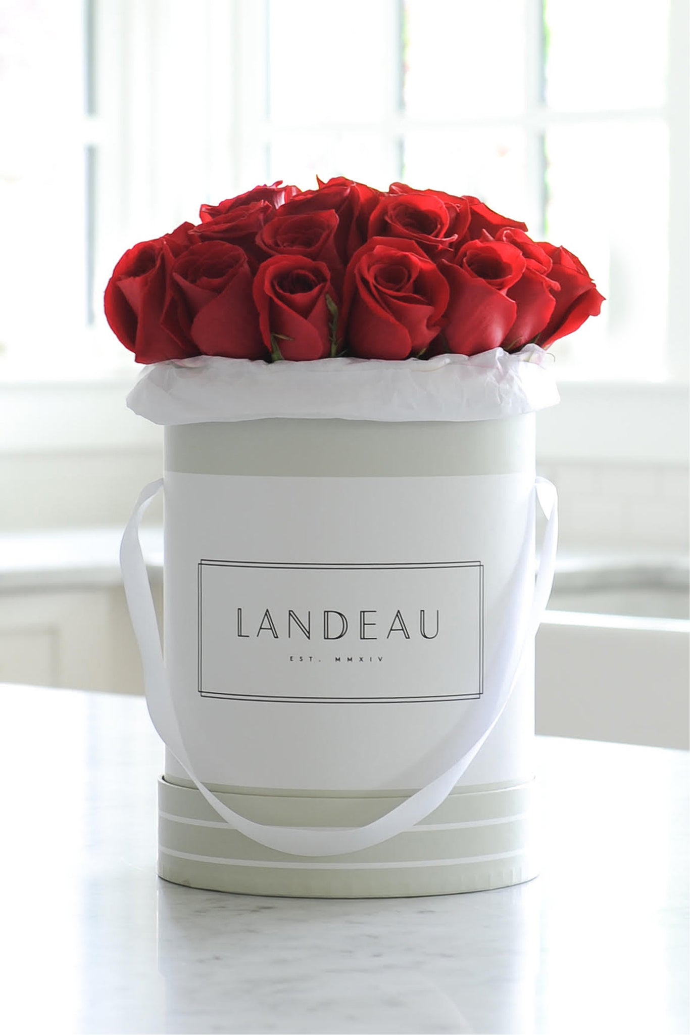 Red Roses available for luxury flower delivery in a bouquet in Chicago, New York City, Portland, Los Angeles, Paris, and San Francisco. 25 Red Roses in a box delivered to celebrate your anniversary or birthday