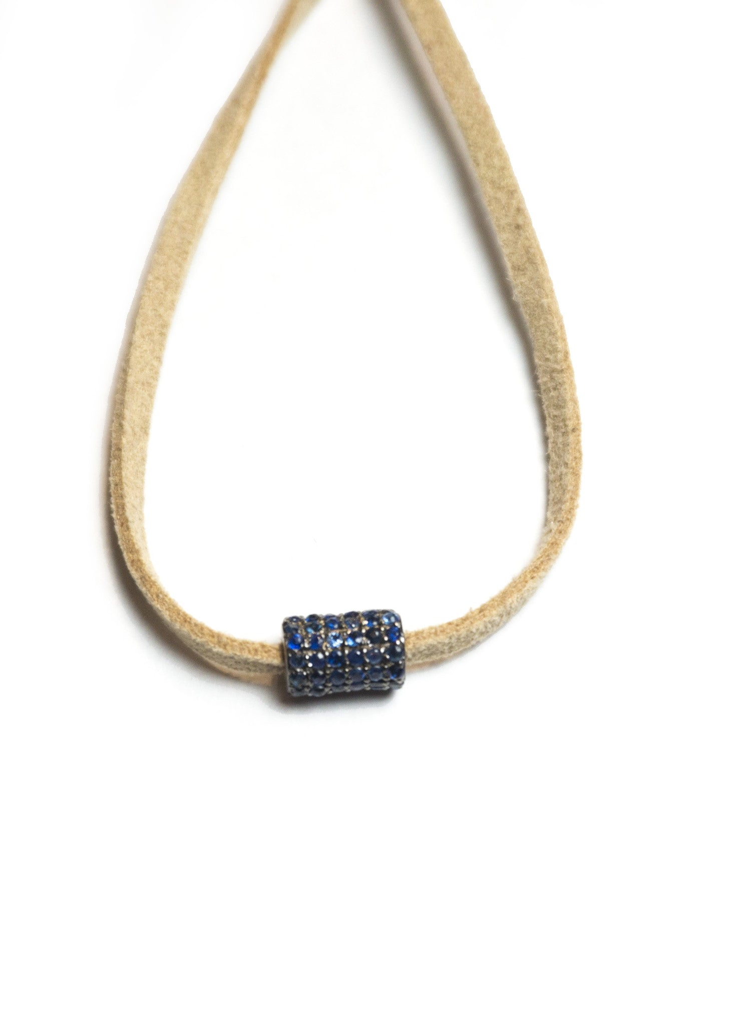 Lera Jewels small sapphire cylinder on tan suede wrap