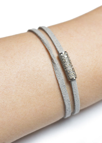 Lera Jewels large pave diamond cylinder on grey suede wrap