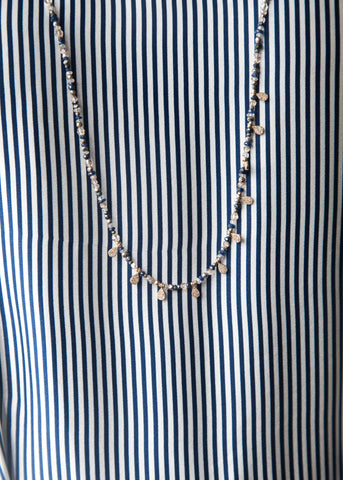 Jen Collection hand beaded necklace with blue sapphires, zircon and diamond charms